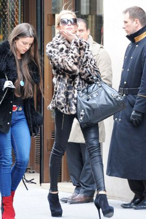 Abigail Clancy is sighted strolling on Rue Saint Honore in Paris, France