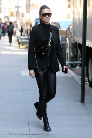 Adriana Lima leaves an office building