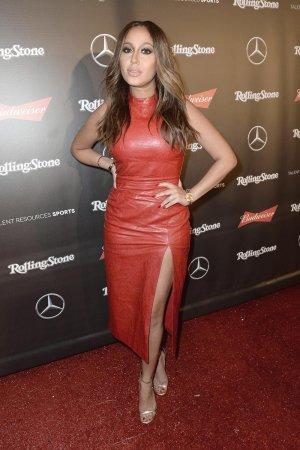 Adrienne Bailon arrives at the Maxim Super Bowl Party