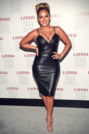 Adrienne Bailon attends the Latina Beauty, Hair & Wellness Expo