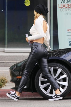 Alexis Ren casting her vote at a ballot box