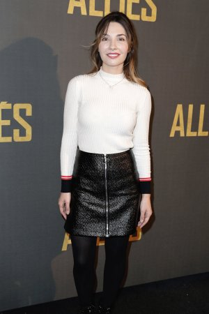 Alix Benezech poses as she arrives for the premiere of the film Allied