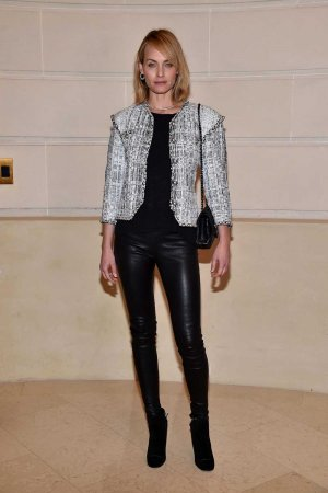 Amber Valletta attends Chanel Collection des Metiers d'Art
