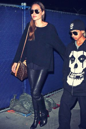 Angelina Jolie rocks leather pants while arriving at LAX Airport