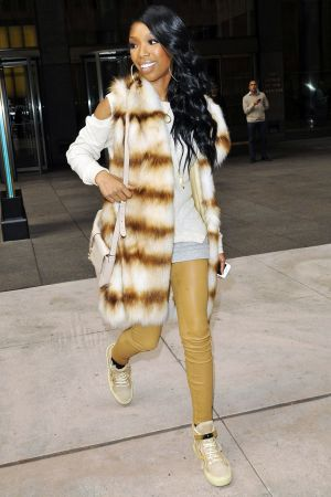 Brandy Norwood out of the NBC building in NY