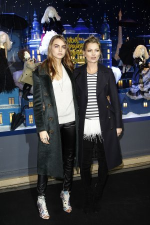 Cara Delevingne and Kate Moss attend the Printemps Christmas Decorations Inauguration