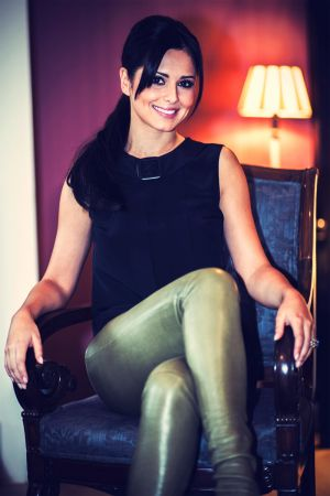 Cheryl Cole poses before her appearance on The Voice