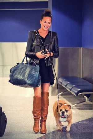 Chrissy Teigen is seen arriving at LAX airport