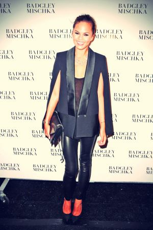 Christine Teigen poses backstage at the Badgley Mischka fashion show