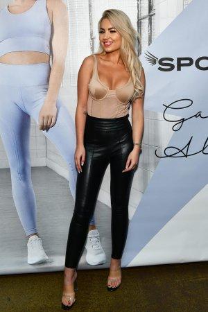 Chyna Ellis attends Gabby Allen's SportFX Clothing Line Launch