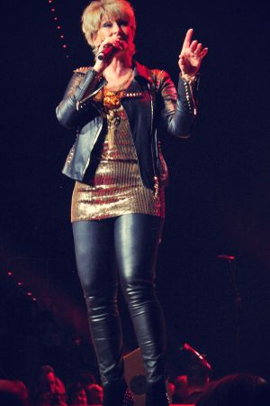 Claudia Jung performing on stage at the SAP Arena