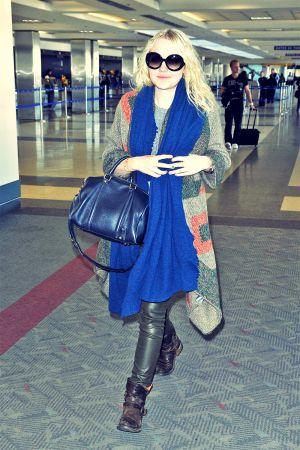 Dakota Fanning departs out of LAX