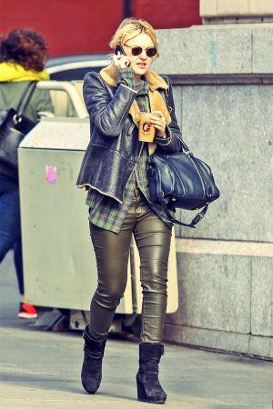 Dakota Fanning strolls through Soho with a cup of coffee