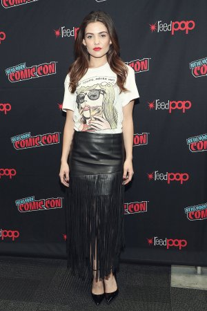 Danielle Campbell walks the red carpet at New York Comic Con