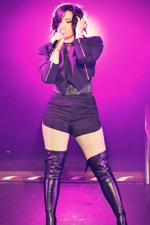 Demi Lovato performing at the Crowne Theatre