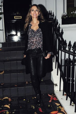 Elizabeth Hurley leaving her house