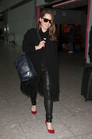 Emilia Clarke Walks through Heathrow Airport