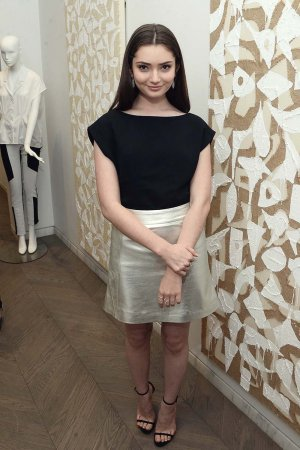 Emily Robinson attends the 1 Year Anniversary of Kimora Lee Simmons