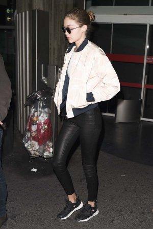 Gigi Hadid arrives at Paris CDG Airport