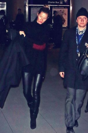 Gisele Bundchen is seen as she arrives at Logan International Airport
