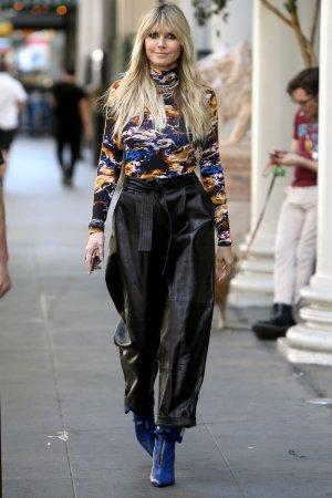 Heidi Klum walking to the Germany's Next Topmodel set