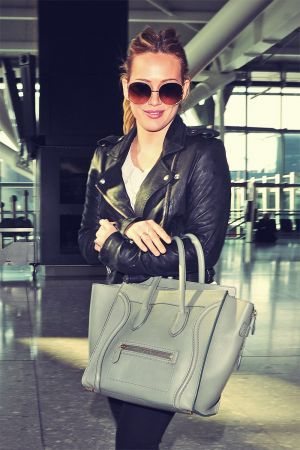 Hilary Duff makes her way through Heathrow Airport