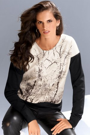 Izabel Goulart poses for MADELEINE Fall/Winter 2014 Collection