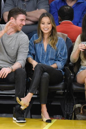 Jamie Chung attends a basketball game