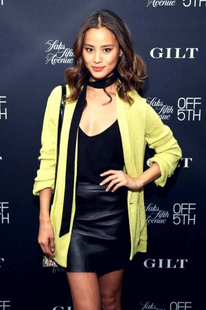 Jamie Chung attends the Saks celebration