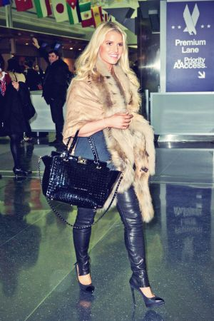 Jessica Simpson arriving on a flight at JFK Airport