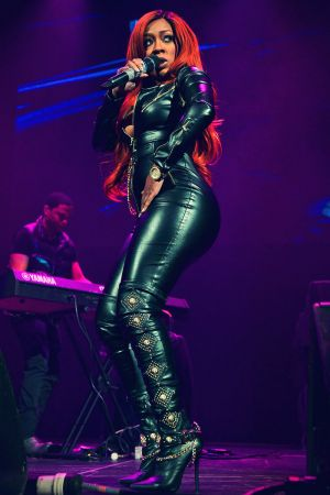 K Michelle performs in leather catsuit