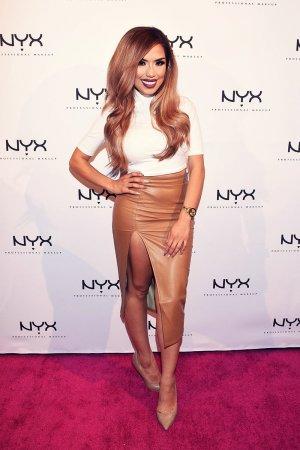 Karen Sarahi attends the NYX Cosmetics Grand Opening