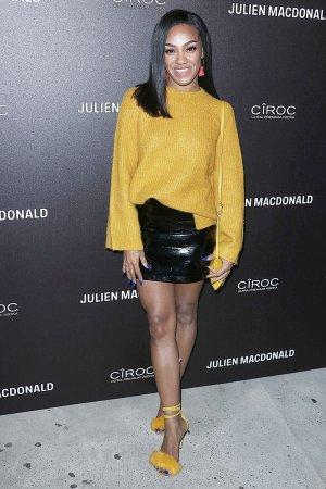 Karis Anderson attends Julien Macdonald show