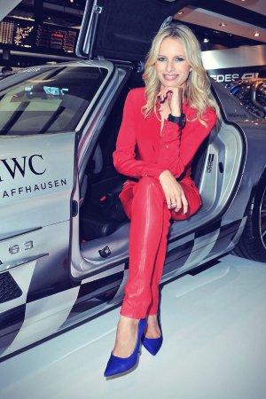 Karolina Kurkova visits the IWC booth during the SIHH