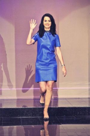 Katy Perry rocks a short blue dress while making an appearance on The Tonight Show