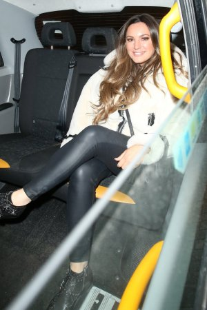 Kelly Brook seen looking cheerful after leaving Heart Radio