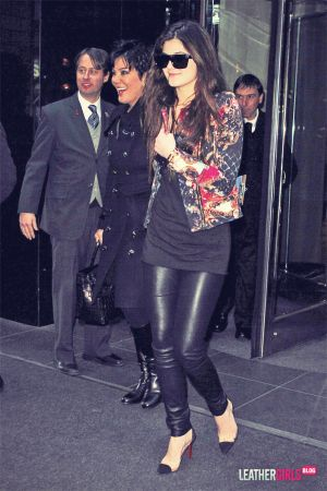 Kendall Jenner hides behind a friend while leaving her hotel in NYC Hotel