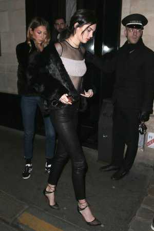 Kendall Jenner leaves a restaurant after the Givenchy show