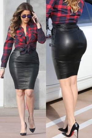 Khloe Kardashian rocks a tight black leather skirt while filming in Calabasas