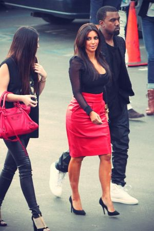 Kim Kardashian arrive at an X-Factor