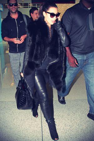 Kim Kardashian arriving at Miami International Airport