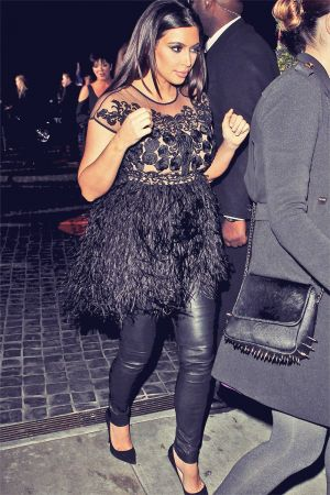 Kim Kardashian attending party fotr Top Shop at Cecconi's