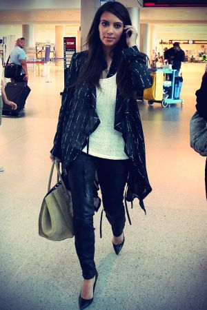 Kim Kardashian catches a flight out of Miami