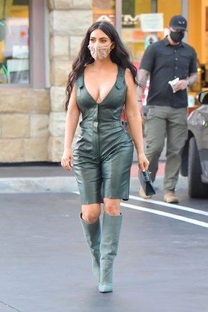 Kim Kardashian wears a mask as she's seen in LA