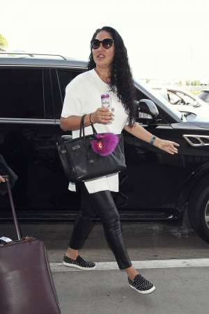 Kimora Lee Simmons catches a flight out of LAX