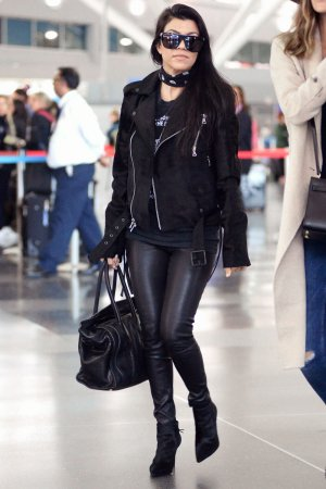 Kourtney Kardashian is seen at LAX and JFK airports