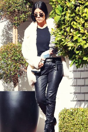 Kourtney Kardashian makes her way out of a building