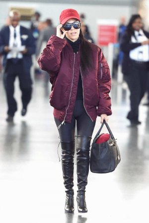 Kourtney Kardashian making her way through JFK airport