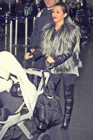 Kourtney Kardashian Returns To Los Angeles