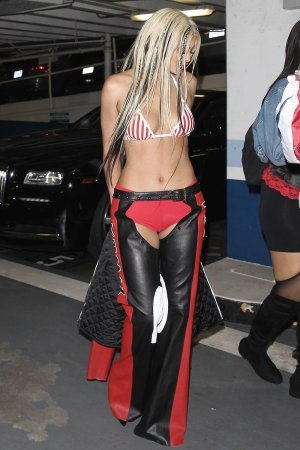Kylie Jenner dressed as Dirty X-tina attends Bootsy Bellows Halloween party